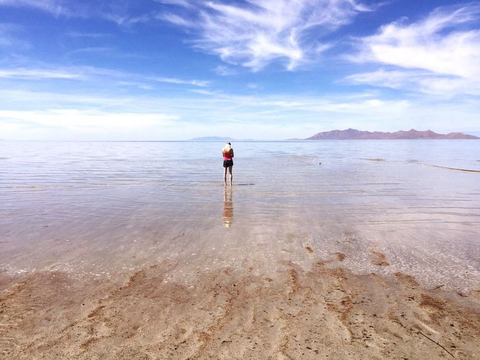 Rear View Of Woman Standing On Shore At Great Salt Lake