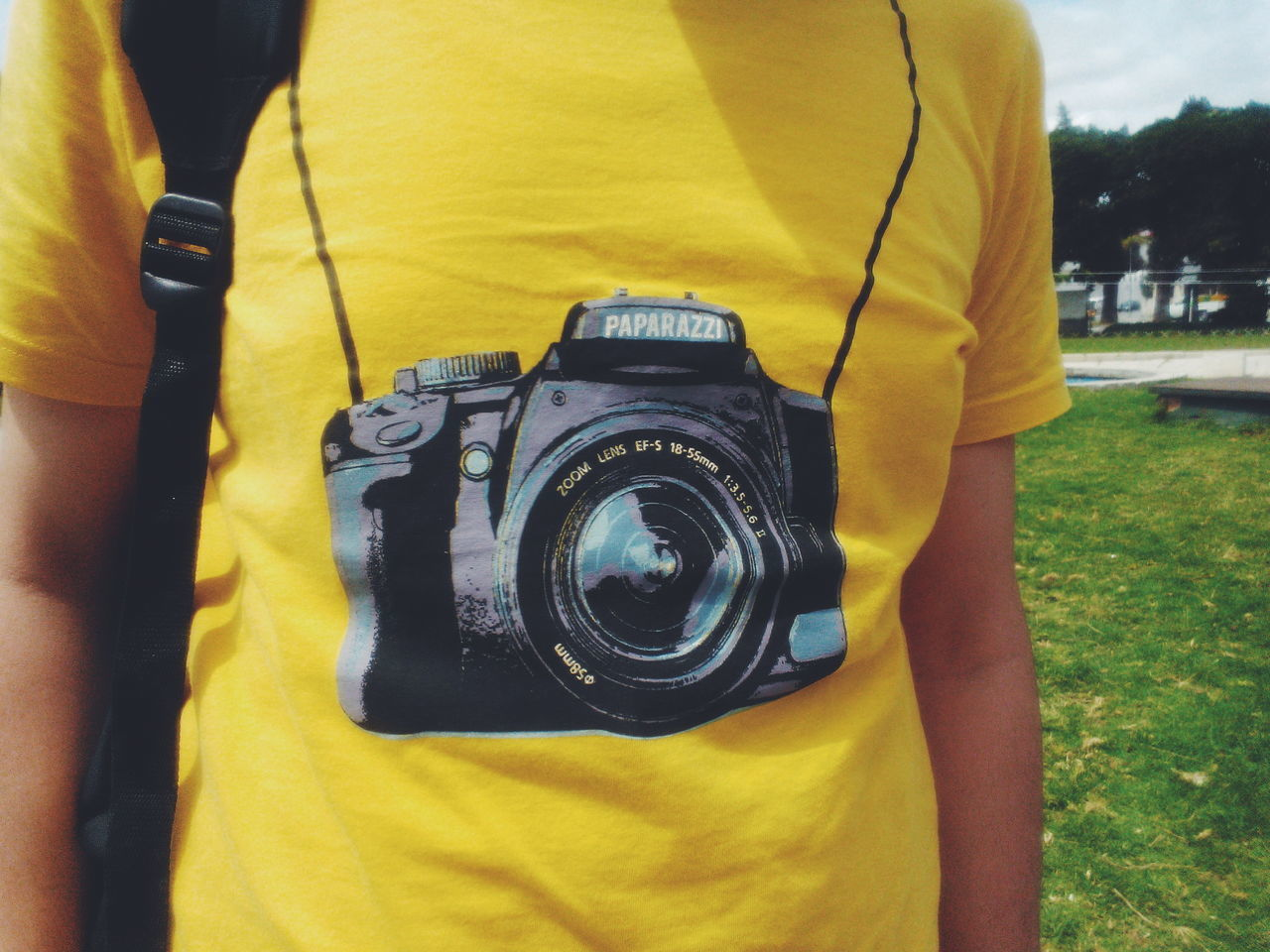 midsection, one person, photography themes, yellow, real people, camera - photographic equipment, technology, casual clothing, leisure activity, holding, focus on foreground, men, lifestyles, day, close-up, standing, photographing, activity, digital camera, photographer, slr camera