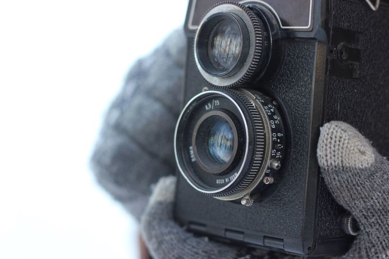Cropped Hand Photographing Through Vintage Camera
