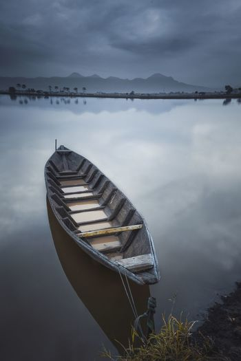 Boat Moored In Water Against Sky