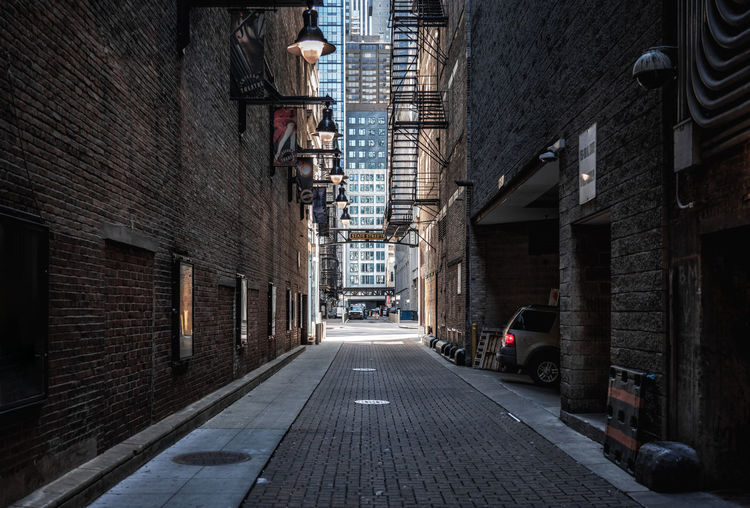 Chicago alley near theater district Architecture Building Exterior Built Structure The Way Forward City Direction Building Street Alley Diminishing Perspective Footpath Narrow Outdoors No People Brick Chicago Illinois USA America Brick Wall Illuminated Theater District Stairs Daytime Empty Downtown