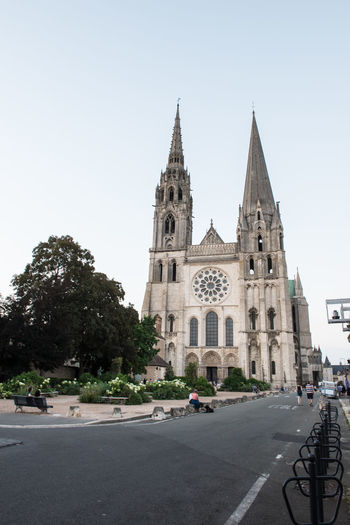 Chartres Cathedral, France Cathedral Chartres Cathedral Chartres, France Architecture Building Building Exterior Built Structure Car City Clear Sky Day Incidental People Mode Of Transportation Motor Vehicle Nature Outdoors Place Of Worship Plant Religion Road Sky Spire  Street Transportation Tree