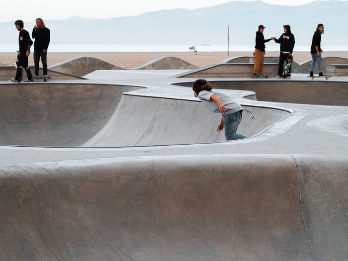 Rear view of people on skateboard