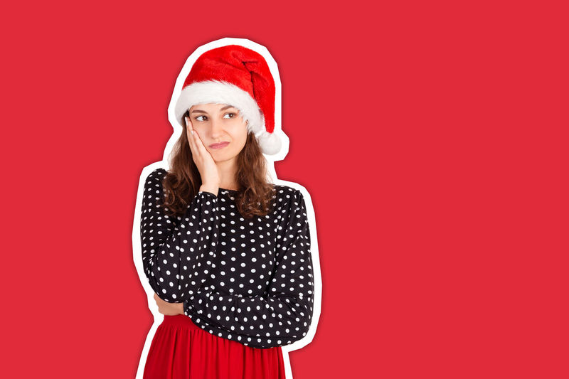 Portrait of mid adult woman against red background