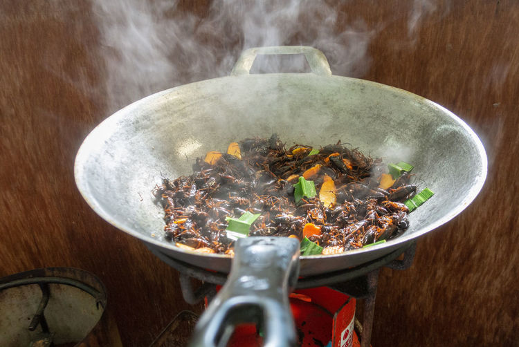 Cooking Burning Close-up Cooking Pan Cricket Fried Eating Utensil Food Food And Drink Freshness Heat - Temperature High Angle View Household Equipment Indoors  Kitchen Utensil Meat No People Preparation  Preparing Food Smoke - Physical Structure Steam Table Vegetable Wood - Material