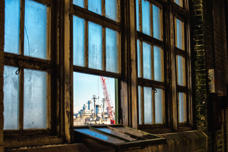 View of a shipyard out an old window Abandoned Abandoned Buildings Abandoned Places Abandonedplaces Architecture Deterioration Window Window View Interior Views Interior