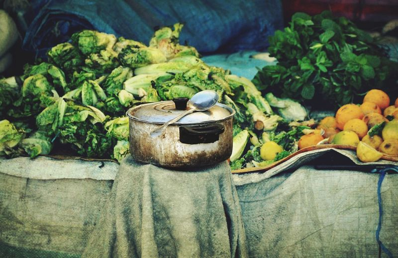Cooking Utensil Against Chinese Cabbages At Market