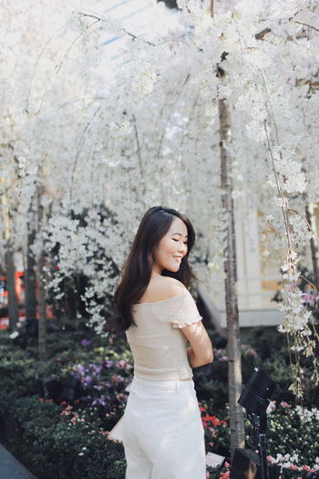 My Best Photo International Women's Day 2019 Streetwise Photography One Person Plant Real People Young Women Standing Young Adult Tree Lifestyles Leisure Activity Women Flower Hair Long Hair Flowering Plant Beautiful Woman Adult Hairstyle Three Quarter Length Beauty Outdoors