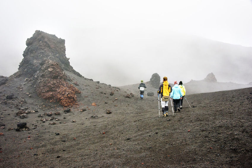 Hikers go through volcanic desert at Kamchatka Adult Adults Only Day Far East Fog Full Length Group Of People Hiking Kamchatka Landscape Men Mountain Nature Only Men Outdoors People Physical Geography Rear View Russia Scenics Sulphur Travel Vacations