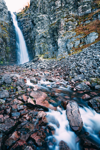 Scenic View Of Waterfall At Forest