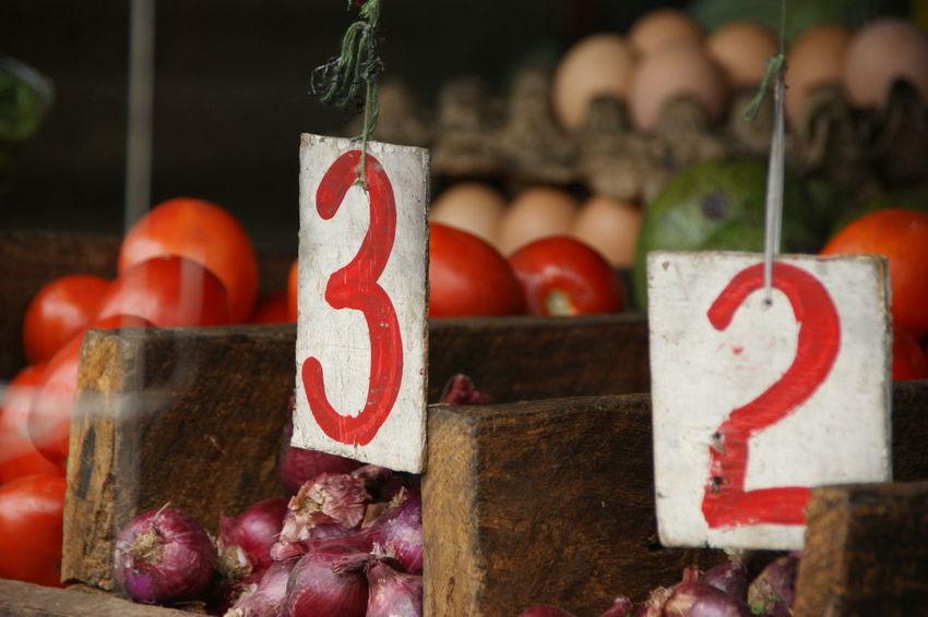 Market day in Kibera, Nairobi Close-up Earning Focus On Foreground Food For Sale Kenya Kibera Market Market Nairobi Number Numbers Price Tag Tomatoes Vegetables