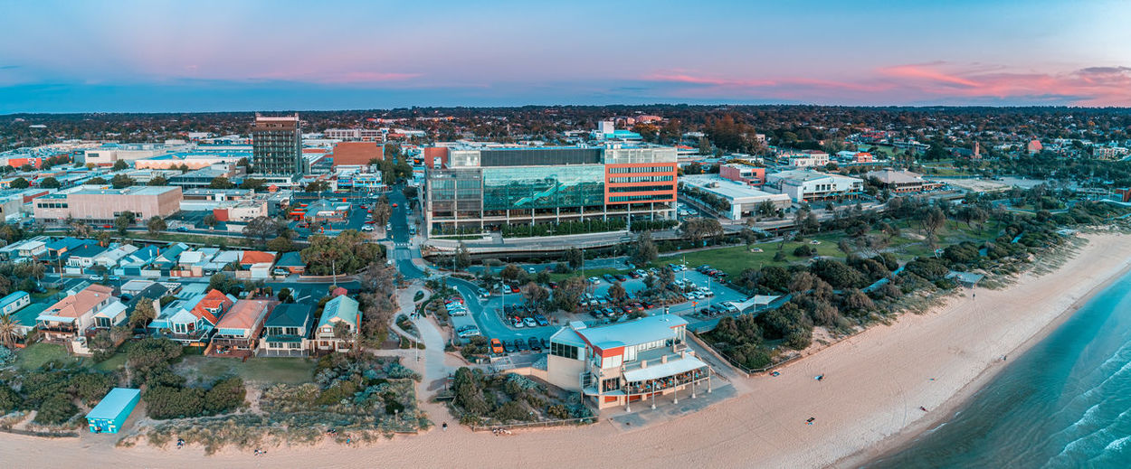 Aerial panorama of south east water head office building and waves cafe at sunset in frankston