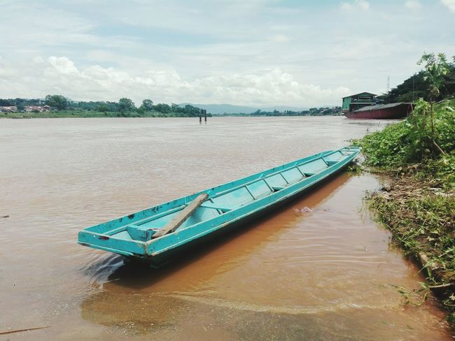Water Cloud - Sky Outdoors Beauty In Nature Day Sky Ship Blue boat Mekong River Mountain One Boat