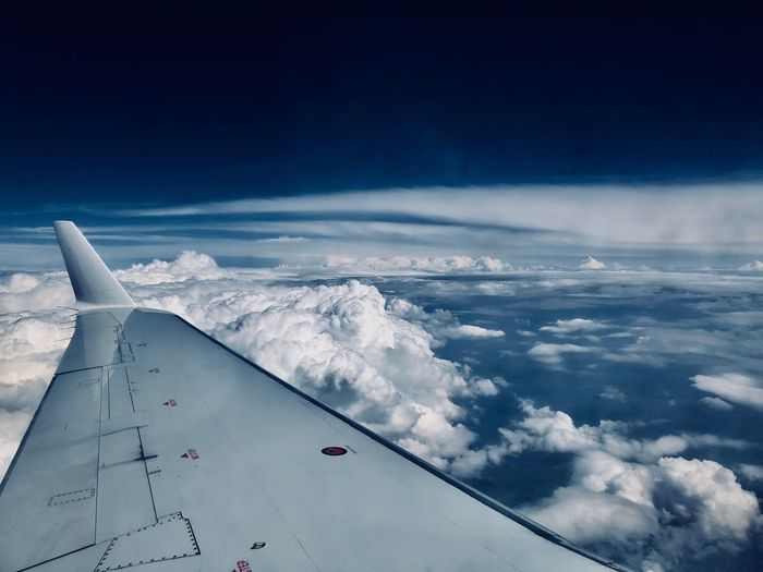 Cropped image of aircraft wing against sky