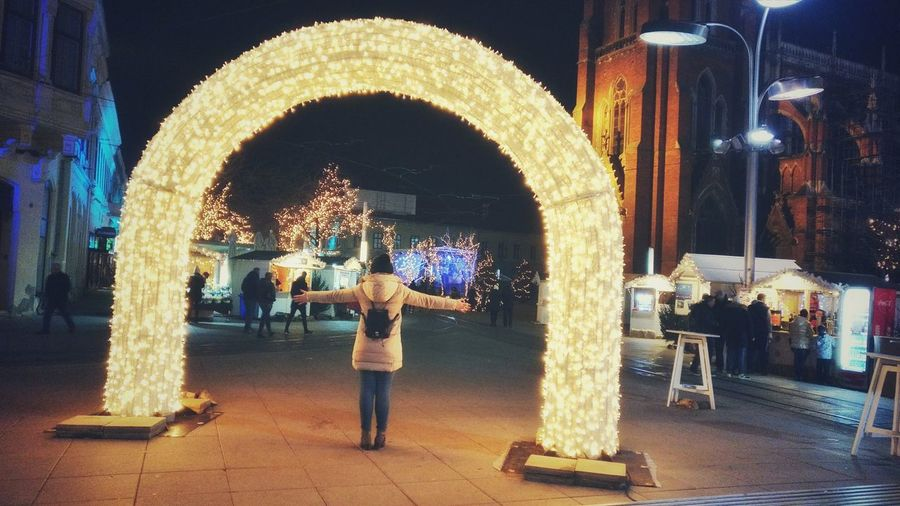 gate NeverSettle Oneplus Oneplus3 Shotononeplus Advent Osijek City Cityscape Cameraphone Smartphone Snapseed Christmas Decoration Smartphonephotography Nightphotography Advent Nightphotography Night Arch Illuminated Real People Outdoors Men Lifestyles Women One Person Architecture People