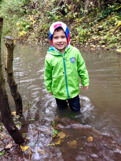 Autumn Weather Makes For Good Play Kids Playing In The Water Deep Stream Childhood Looking At Camera Smiling Water Happiness Elementary Age Portrait Outdoors Standing Autumn Colors Making The Most Of Mother Nature Wiltshire UK