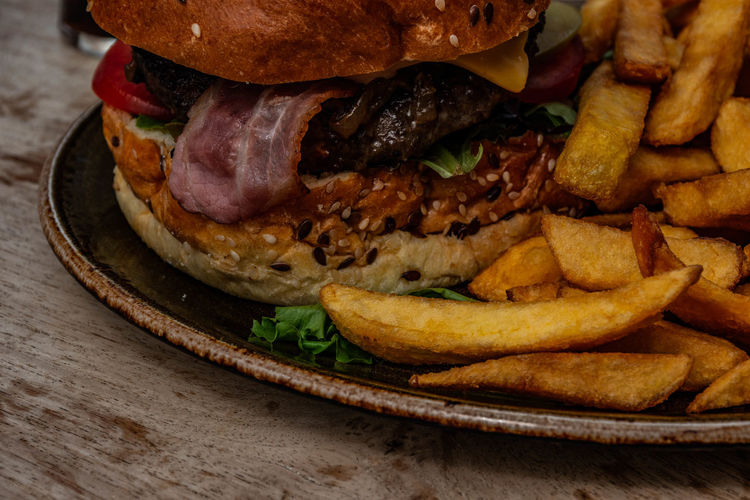 Fast Food Unhealthy Eating Ready-to-eat Sandwich Food And Drink Food Burger Close-up Vegetable Prepared Potato Freshness Potato Hamburger Indoors  French Fries No People Still Life Meat Table Fried Take Out Food Snack Temptation Fast Food French Fries Comfort Food