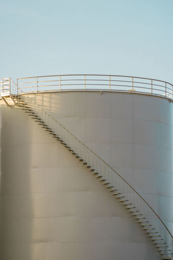 Architecture Nature Sky Railing Day Copy Space Storage Tank No People Staircase Built Structure Fuel And Power Generation Clear Sky Low Angle View Outdoors Fuel Storage Tank Metal Sunlight Steps And Staircases Oil Industry Industry