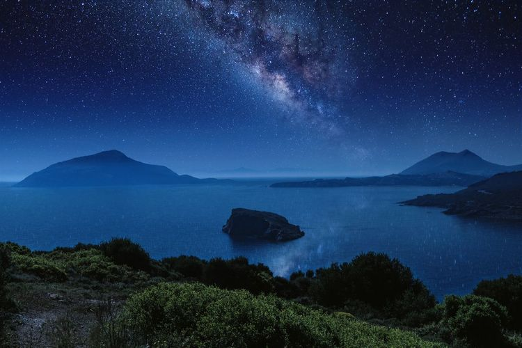 Heaven and earth Greece Sounion Beautiful Destinations Greek Islands EyeEmNewHere Night View Milky Way Poseidon Temple Ancient Greek Astronomy Galaxy Space Milky Way Star - Space Constellation Clear Sky Water Above Coastline Seascape Distant