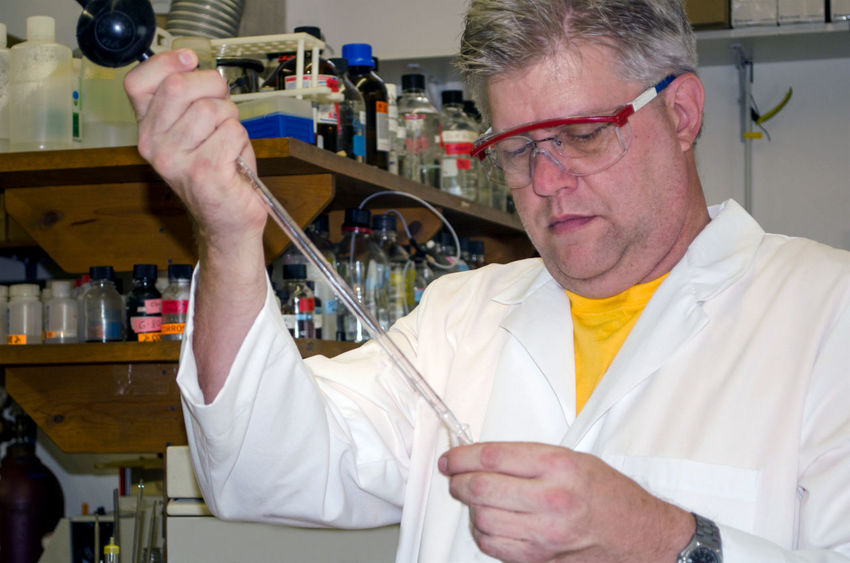 an older man works on chemicals in a science lab Experiment Science And Technology Scientist Adult Chemistry Concentration Examining Expertise Eyeglasses  Glasses Headshot Holding Indoors  Job Lab Coat Mature Adult Mature Men Men Occupation One Person Perching Portrait Senior Adult Skill  Working