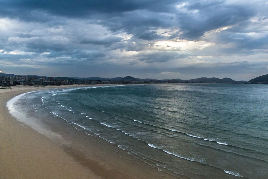This is not your average carribbean beach..! The Great Outdoors With Adobe The Great Outdoors - 2016 EyeEm Awards Laredo Cantabria Spain Cantabria Cantabriainfinita Playa Beach Life Surf Ocean View Waves Landscape_Collection Clouds And Sky Stormy Weather Aerial Shot Drone  Dronephotography Flying High