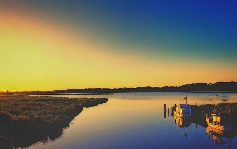 Orange Sky Panorama Shot. Beauty In Nature Boats Brink Clear Sky Day Fishing Boat Lake Nature Nautical Vessel No People Outdoors Reflection Reflections Scenics Sky Sunset Tranquil Scene Tranquility Water Waterfront Watersideview