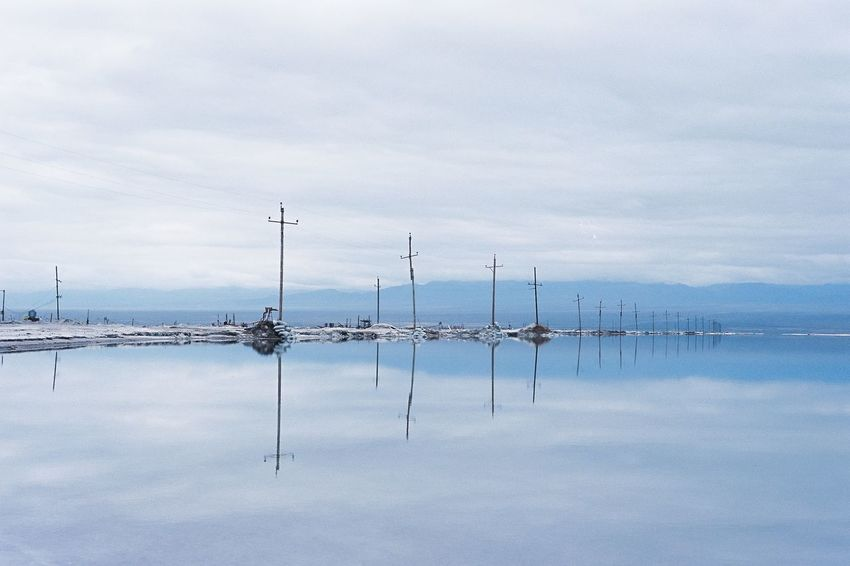 Film Photography Water Sky Cloud - Sky Reflection Alternative Energy Nature No People Wind Turbine Wind Power Outdoors Transportation Day Lake Tranquil Scene Fuel And Power Generation Tranquility Beauty In Nature Windmill Nautical Vessel Scenics