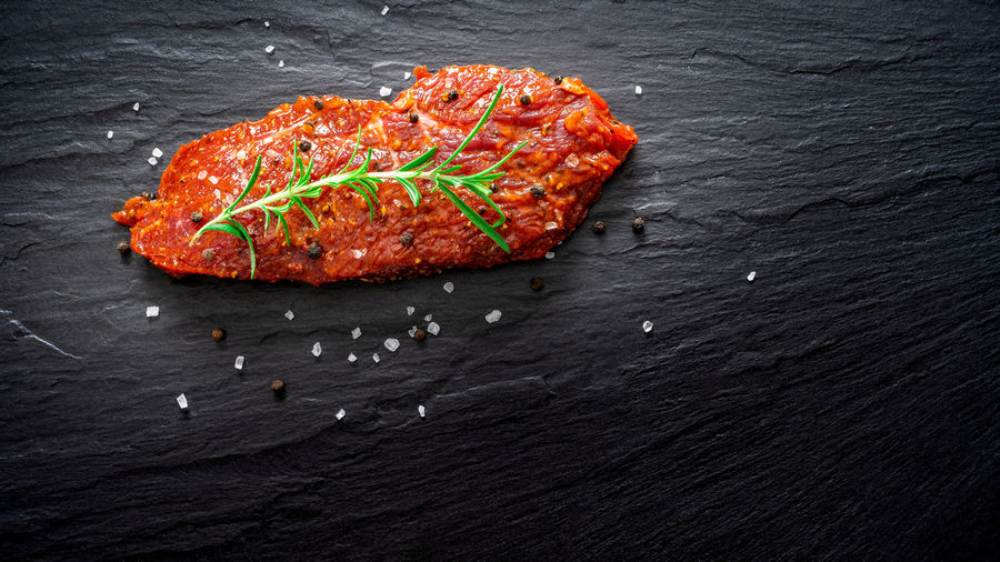 Raw marinated meat, beef steak on black slate background, top view Food And Drink Food No People Freshness Meat Close-up Indoors  High Angle View Black Background Wood - Material Red Black Color Vegetable Slate - Rock Studio Shot Still Life Healthy Eating Table Spice Animal BBQ Raw Food