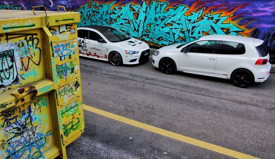 Cars2 Car Motor Vehicle Transportation City Mode Of Transportation Graffiti Road Street Art Day Multi Colored Communication City Life No People Creativity Sign Street Land Vehicle Architecture Art And Craft Symbol