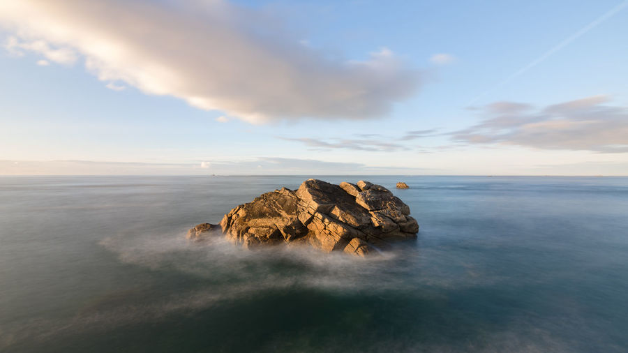 Long exposure of large rock in the sea during sunset, France, Brittany, Finistere Sky Scenics - Nature Beauty In Nature Water Tranquil Scene Sea Tranquility Rock Rock - Object Solid Idyllic No People Non-urban Scene Nature Long Exposure Land Horizon Over Water Outdoors France Bretagne Bretagnetourisme Coastline Finistere Ocean View Waves, Ocean, Nature Tide Sunset