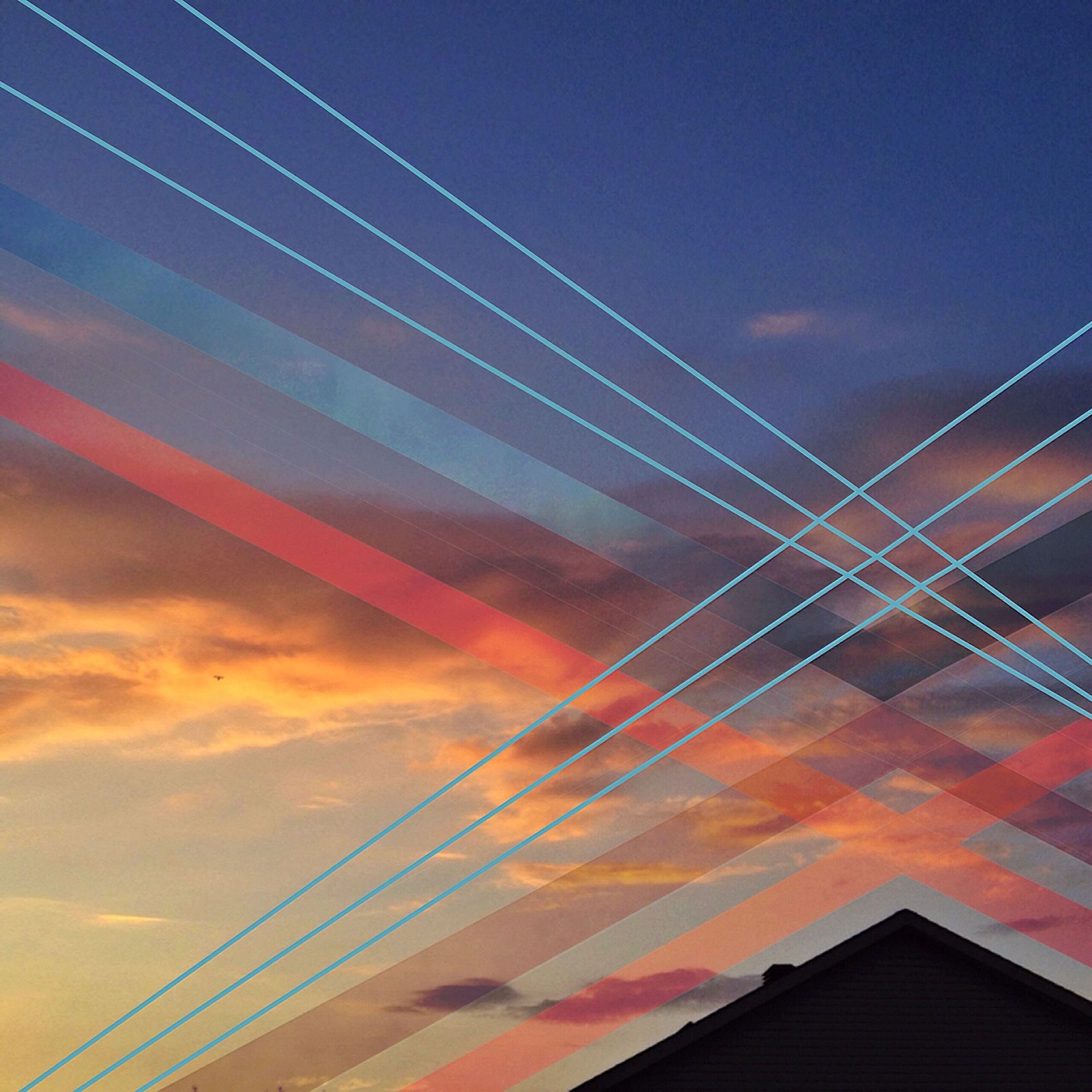 low angle view, built structure, architecture, sky, connection, building exterior, sunset, cloud - sky, bridge - man made structure, cable, blue, no people, outdoors, cloud, orange color, city, vapor trail, high section, modern, dusk