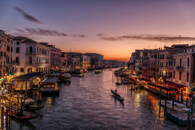 From the Rialto Bridge Nautical Vessel Water Transportation Sky Mode Of Transportation Building Exterior Architecture Sunset City Built Structure Canal Cloud - Sky Nature Dusk Travel Destinations Illuminated Waterfront Gondola - Traditional Boat Travel No People Outdoors Cityscape Passenger Craft Tourist Attraction  Tourist Destination