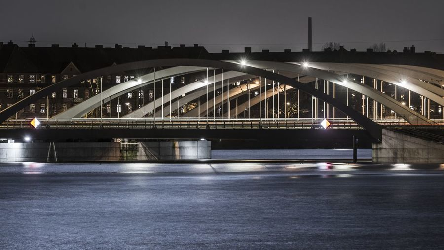 Illuminated bridge at port of hamburg at night