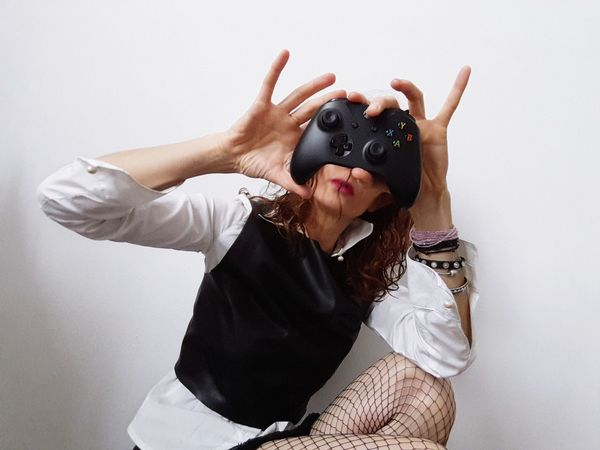 Fishnets EyeEm Selects One Woman Only Only Women Waist Up One Person Gesturing Humor Disguise Fun Human Body Part Adult Adults Only Eye Mask Human Mouth People Studio Shot Portrait Indoors  One Young Woman Only White Background Young Adult Women Play Time Player EyeEmNewHere