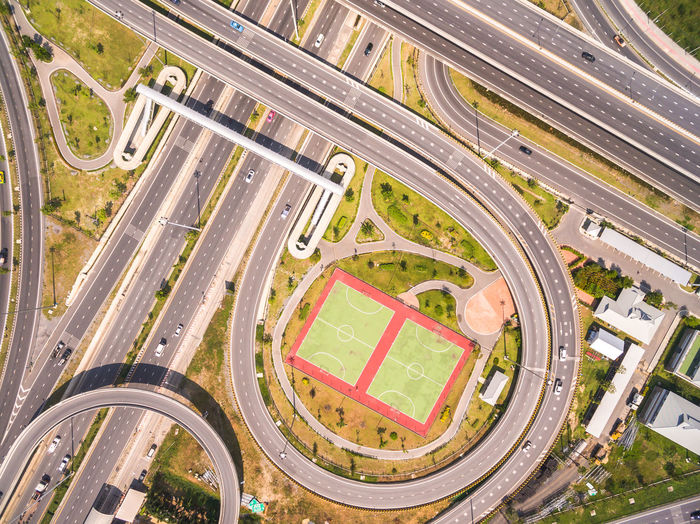 Aerial View City Cityscape Day High Angle View Highway Modern No People Outdoors Road Road Intersection Stadium Traffic Traffic Circle Transportation