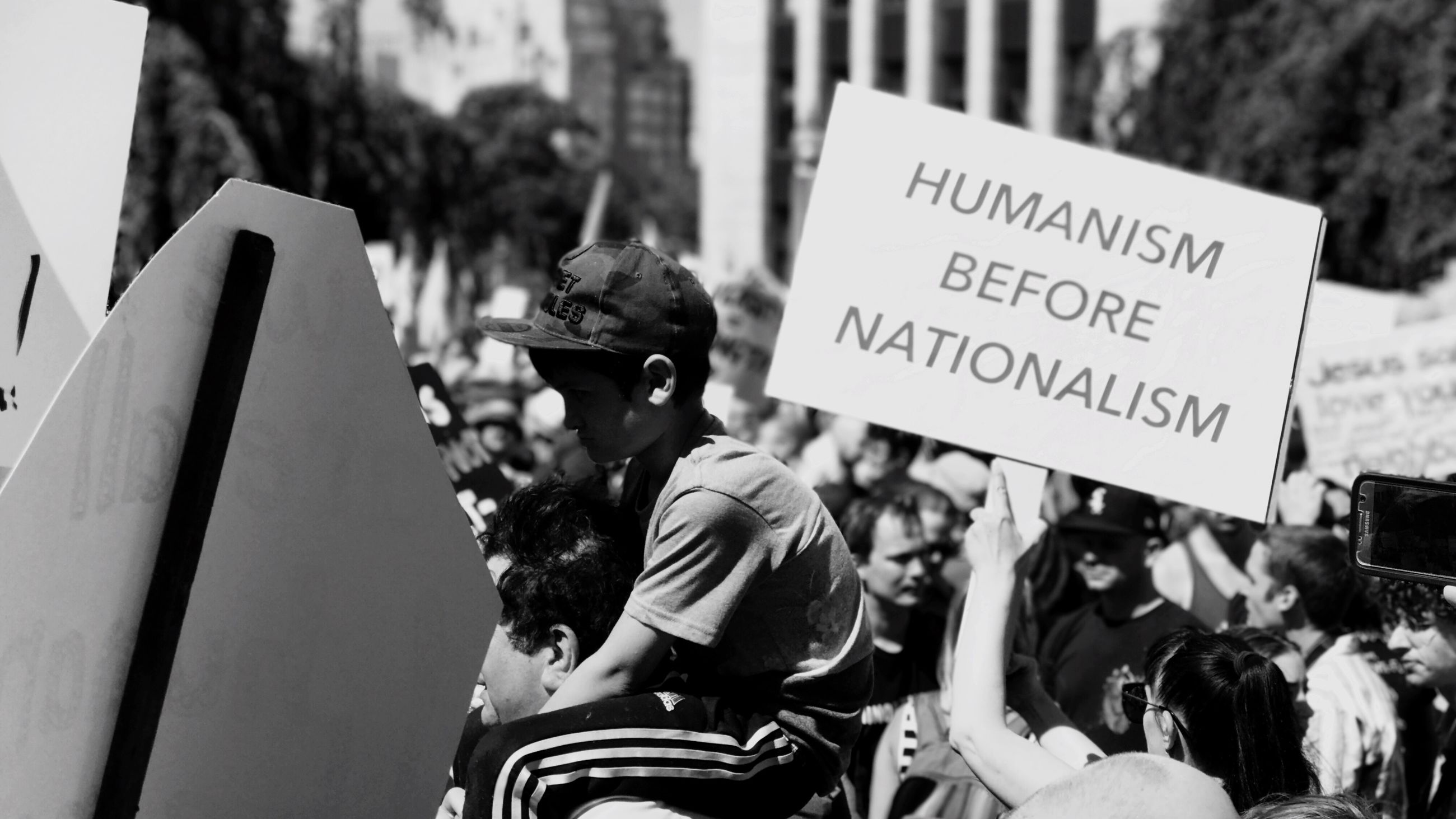 text, protest, communication, real people, placard, protestor, men, women, holding, day, outdoors, togetherness, adult, people