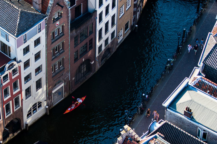 Water Real People Canal People Men Leisure Activity Nature City Nautical Vessel High Angle View Built Structure Transportation Group Of People Building Exterior Outdoors Day Architecture Crowd Adult Lifestyles
