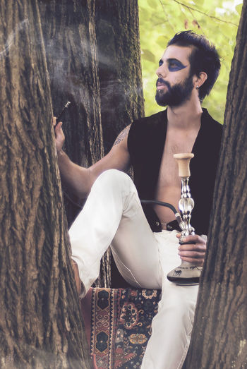 Alice Alice In Wonderland Aliceinwonderland Bearded Boy Caterpillar Fashion My Vision Outdoors Photography Portrait Real People Shooting Tree Tree Trunk