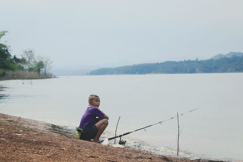 Hobby Boys Alone Alone Time Child Full Length Water Sitting Childhood Boys Lake Clear Sky Fishing Males  Fishing Rod Fisherman Fishing Hook Ocean Fishing Pole Fishing Equipment Skate Photography: Same Tricks, New Perspectives Moms & Dads