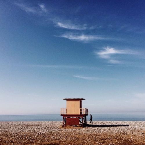 Sea Horizon Over Water Beach Sky Water Nature Blue Tranquility Beauty In Nature Scenics Real People Built Structure Tranquil Scene Sand Day Architecture Men Lifeguard Hut One Person