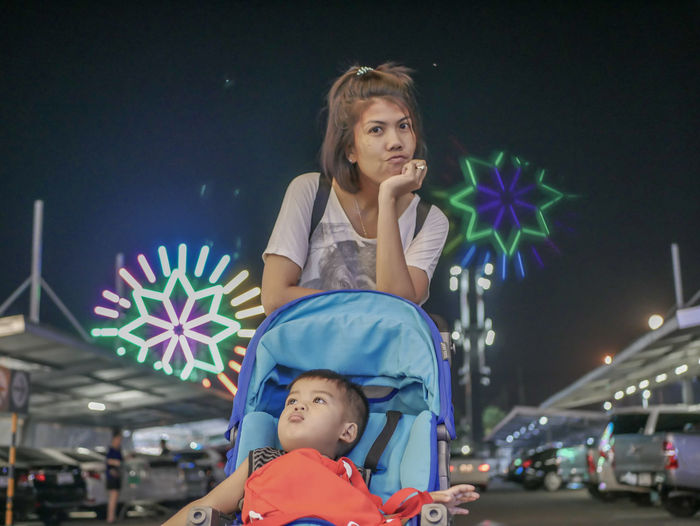 lonely Child Portrait Front View Childhood Real People Night Illuminated Looking People Headshot Looking Away Leisure Activity Casual Clothing Family Innocence Young Adult Standing Capture Tomorrow Moments Of Happiness