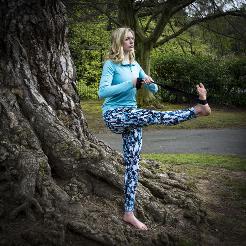 Young woman practicing yoga in a park and church yard. Day Health Lifestyle Mindfulness Peace Peaceful Yoga Yoga Pose Young Woman