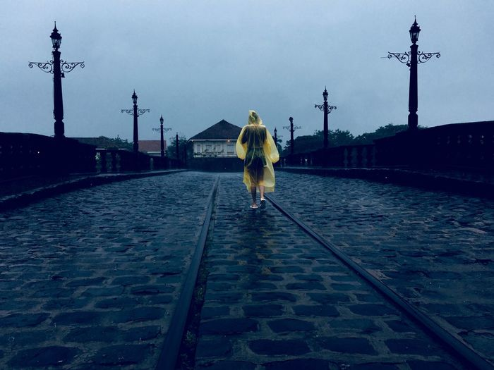 HUAWEI Photo Award: After Dark The Great Outdoors - 2018 EyeEm Awards Full Length Street Sky Real People Rear View One Person The Portraitist - 2018 EyeEm Awards Nature Adult Cobblestone Walking Wet Rain