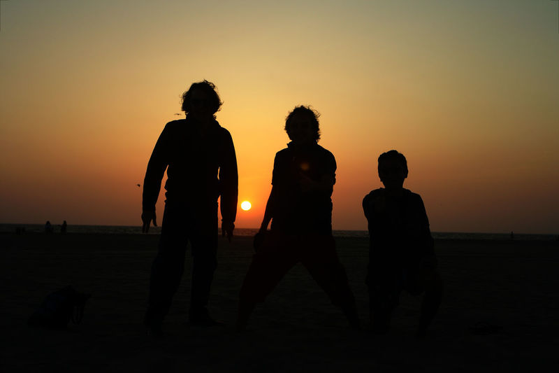 Friends Friends Silhouettes Group Of People People Boys Will Be Boys Boys Three Boys Travel Travel Photography Sunset Silhouettes Sunset Photography Sunset Horizon Magic Hour Sunset By The Beach Playing At The Beach Play Time Silouette And Shadows Sunset Men Full Length Silhouette Desert Togetherness Boys Sky Sand Sandy Beach Horizon Over Water Beach Calm #FREIHEITBERLIN