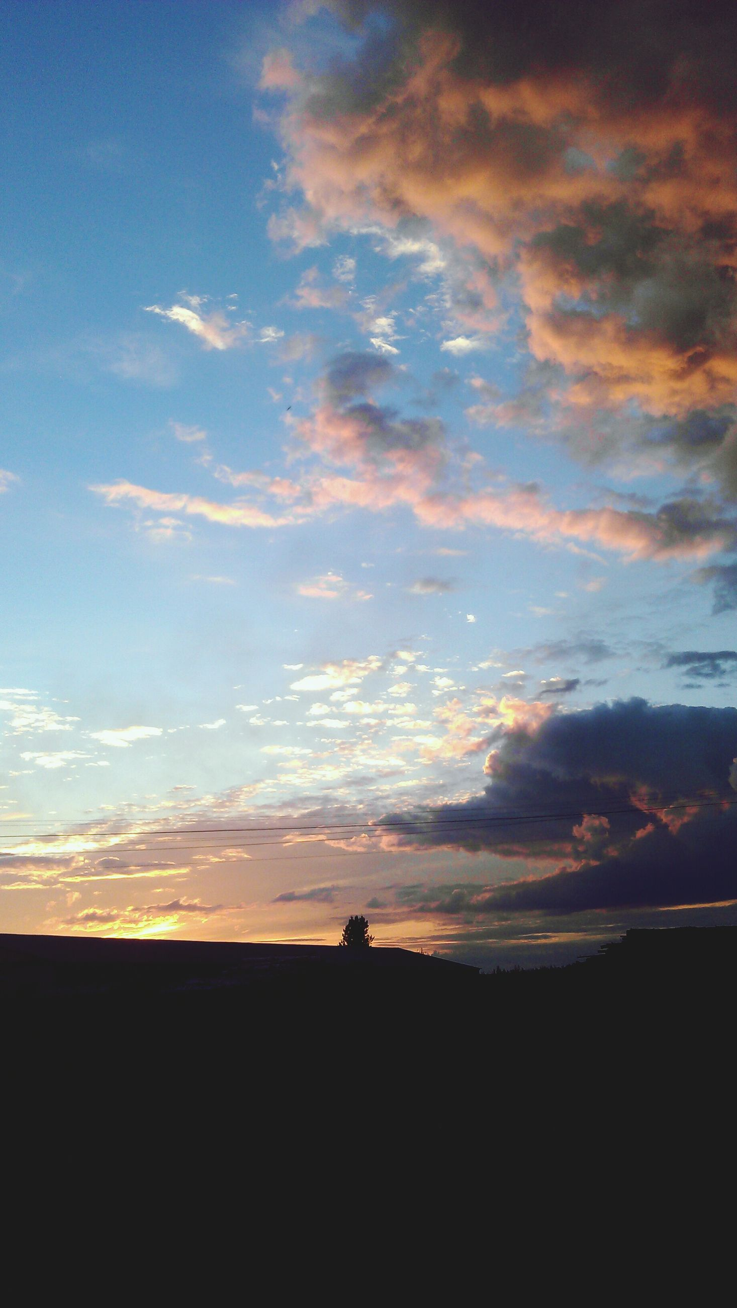 silhouette, sunset, sky, tranquil scene, scenics, tranquility, beauty in nature, cloud - sky, landscape, cloud, nature, idyllic, outline, dark, dusk, horizon over land, dramatic sky, cloudy, outdoors, orange color