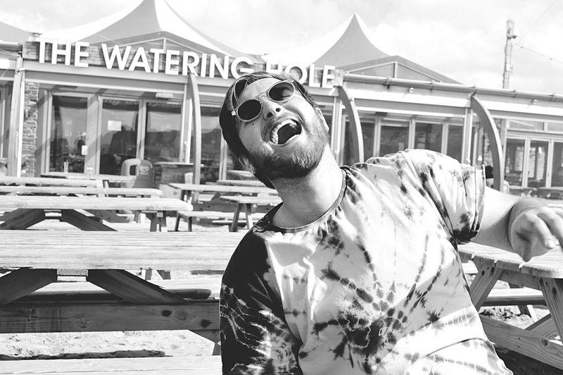 Young Adult Weekend Activities Beard Laughing Hilarious Monochrome Enjoyment Sunglasses EyeEm Best Shots - Black + White Summertime Seaside Outdoor Photography Captured Moment Pub EyeEm Best Shots Hello World Non-urban Scene Outdoors Photography Vacations Blackandwhite Person Tyedye Fashion Hippie