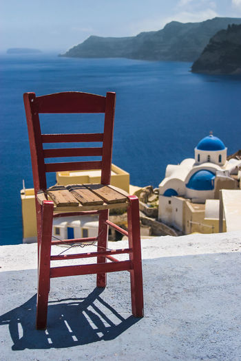 Water Chair Seat Sea Land No People Travel Destinations Nature Relaxation Tranquility Scenics - Nature Trip Vacations Blue Furniture Outdoors Summer