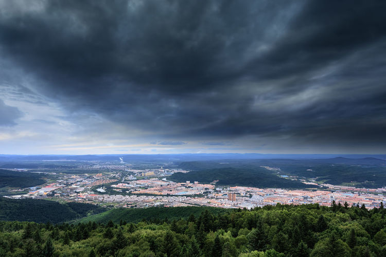 Aerial view of storm clouds over mountains and town. Building Exterior Built Structure City Cityscape Cloud - Sky Cloudy Dark Day Dramatic Sky Forest Green Color Landscape Mountain Nature No People Outdoors Overcast Rain Scenics Storm Storm Cloud Stormy Stormy Weather Town Tree