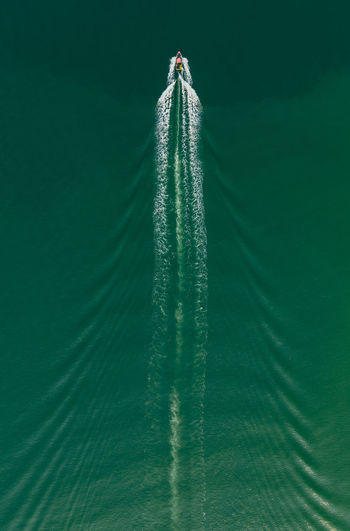 Aerial view of boat in sea. Green Color No People Nature Mode Of Transportation Transportation Motion Speed Vapor Trail Nautical Vessel Water Outdoors Wave Pattern Turquoise Colored Waterfront Scenics - Nature Travel Art Boat Water Sport Aerial View Drone  Sky EyeEm Best Shots EyeEm Selects EyeEm Gallery