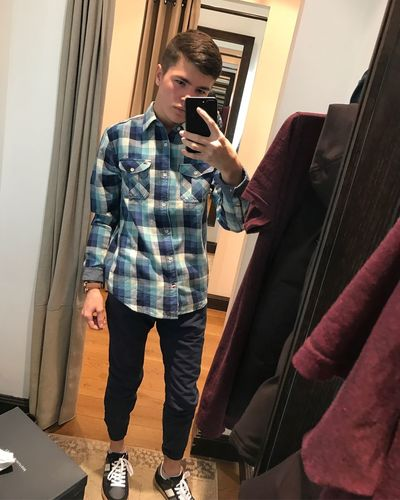 TommyHilfiger Young Adult Young Men Standing Wireless Technology Indoors  Mobile Phone Casual Clothing Leisure Activity One Person Communication Lifestyles Real People Technology One Young Man Only One Man Only Full Length Adult Day Men People First Eyeem Photo